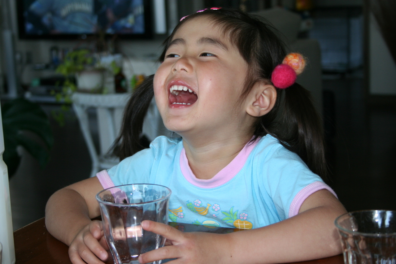Young Japanese girl laughing