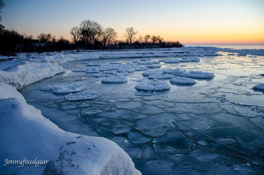 Ice volcanoes. Circles of ice, erupting from a frozen lake.