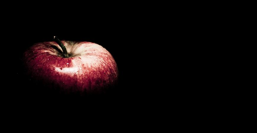 An apple in darkness
