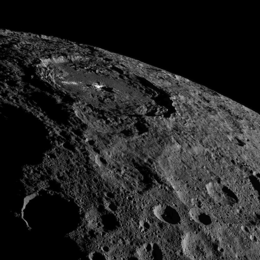 This image of the limb of dwarf planet Ceres shows a section of the northern hemisphere. Prominently featured is Occator Crater, home of Ceres' intriguing brightest areas.