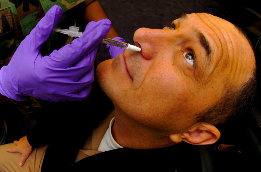 Man receives his annual Influenza vaccine in the form of a nasal mist