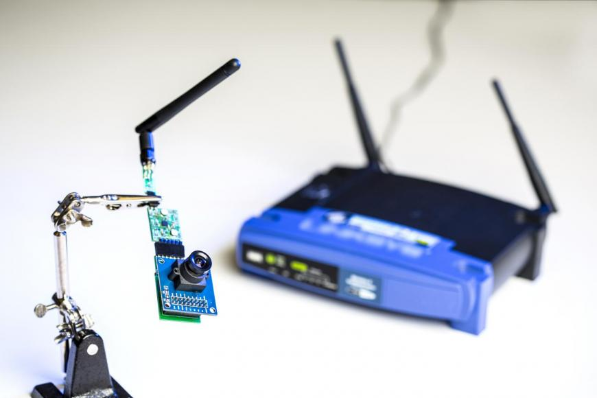WThe UW team used ambient signals from this Wi-Fi router to power sensors in a low-resolution camera and other devices.