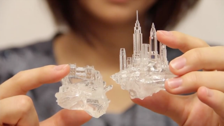 3D printed, transparent shells for hermit crabs, tiny cityscapes rise off the backs of each one.