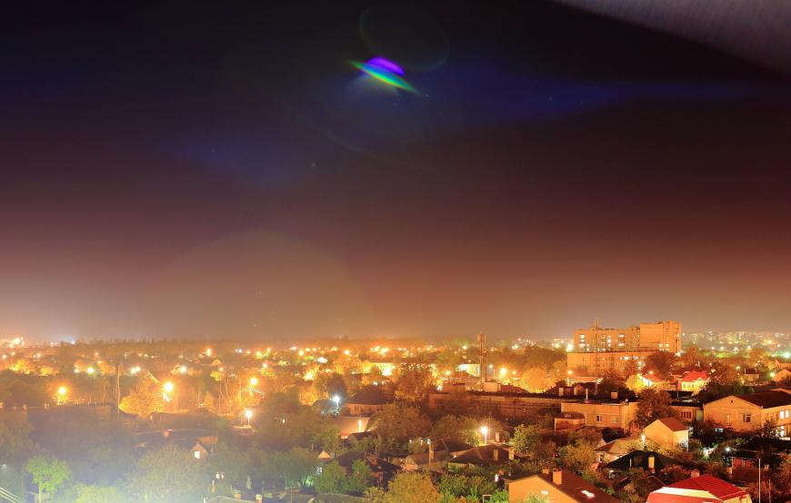 UFO above a city skyline