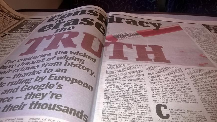 Headline in newspaper: Conspiracy to Conceal the Truth