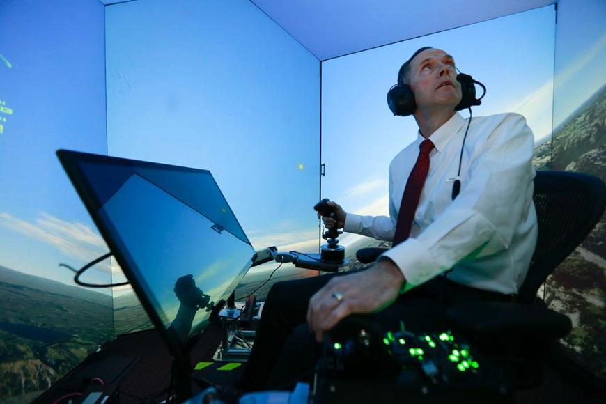 Retired US Air Force Colonel, Gene Lee, in a flight simulator