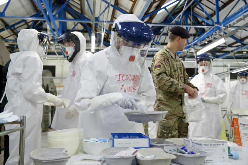 NHS doctors and nurses practise medical care in full protective Ebola gear