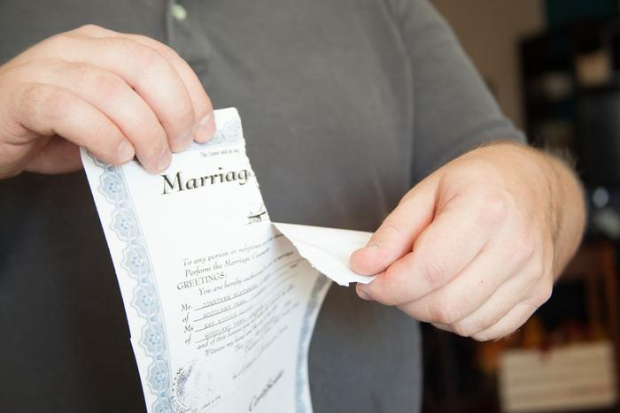Man ripping up a marriage contract