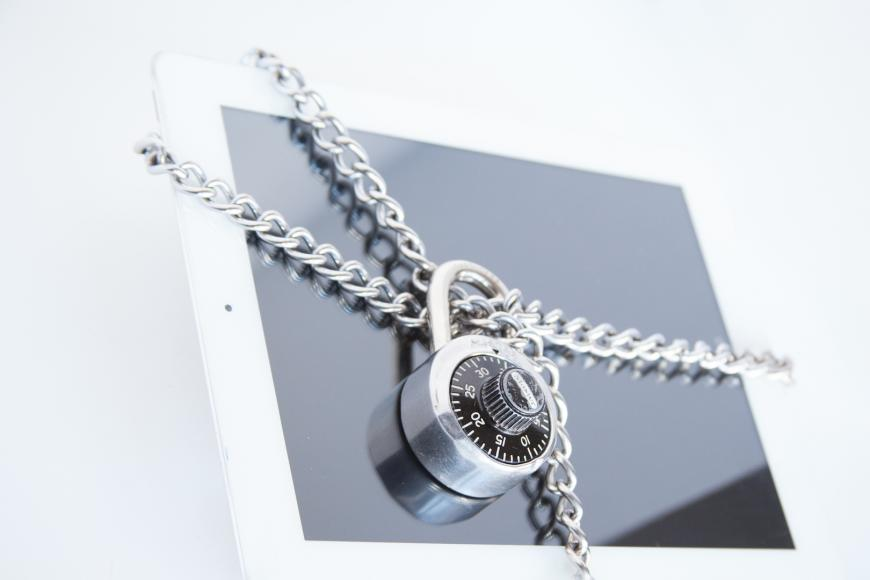Padlock around a tablet. Cyber security