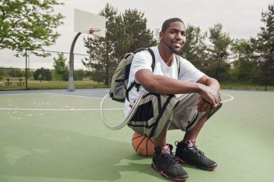 Man sitting in basketball court
