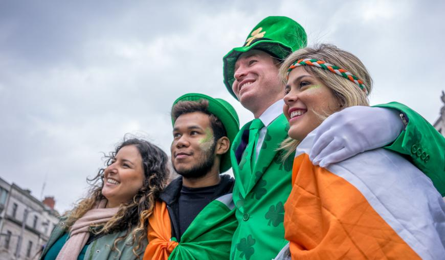 Four people celebrating St. Patrick's day in Dublin, Ireland