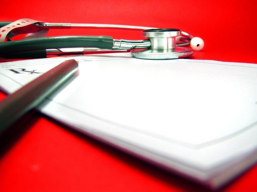 Stethoscope, prescription pad, pencil. Medical doctor