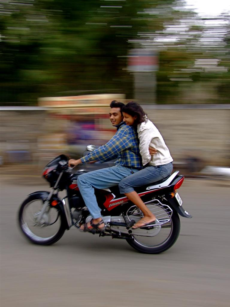 Man and woman riding a motorcycle