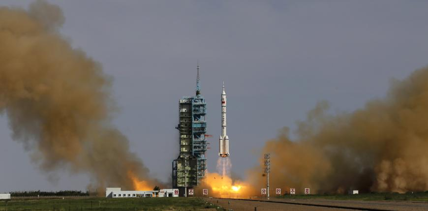 The Changzheng-2F rocket with the Shenzhou-10 manned spacecraft carries three Chinese astronauts to the space station Tiangong-1.