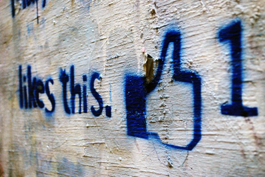 Facebook graffiti. Likes this. Thumbs Up.