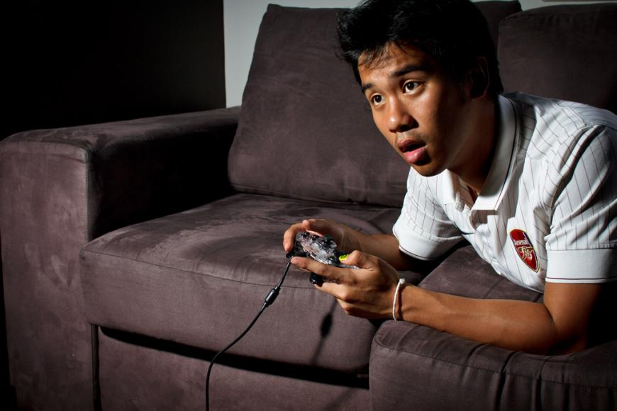 Man playing video game on an Xbox