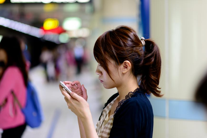 Woman texting on a smartphone