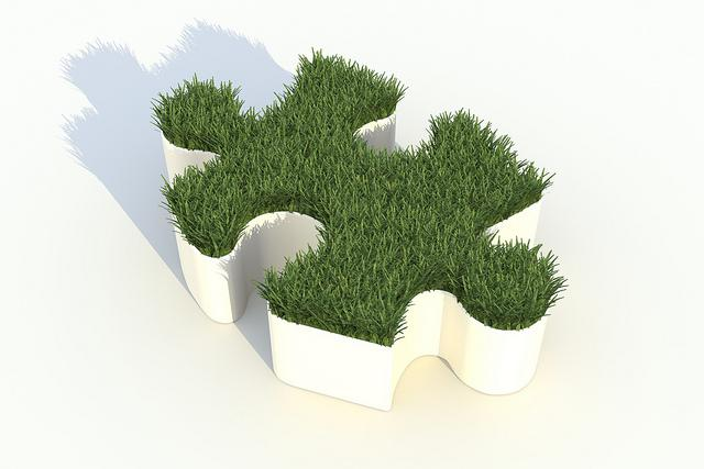 3D puzzle piece containing grass