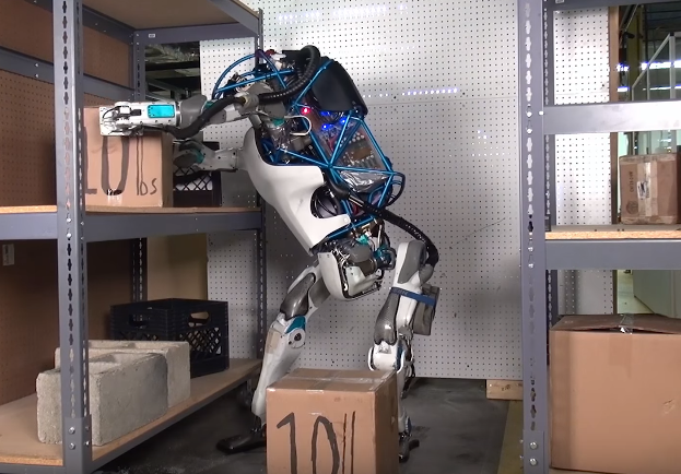 Atlas robot picks up boxes