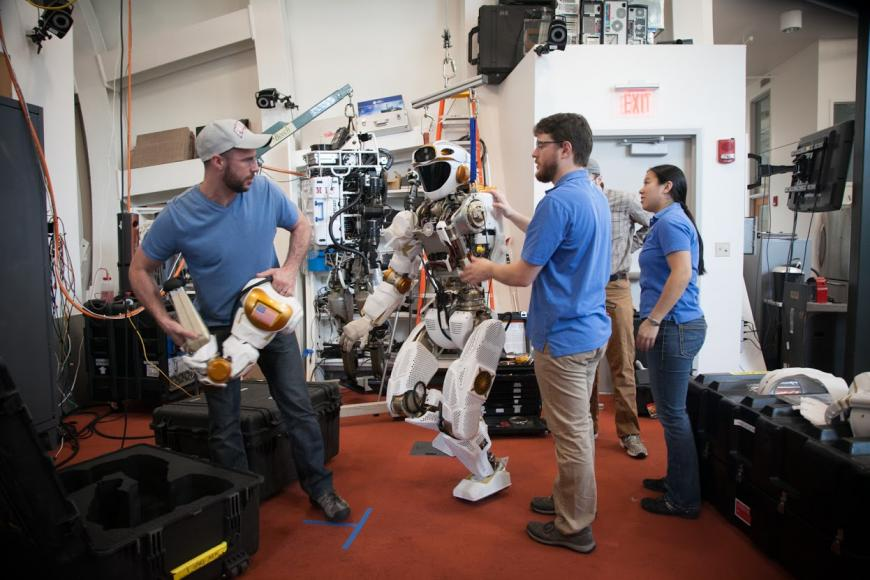 Valkyrie the NASA robot surrounded by researchers at MIT CSAIL