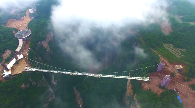 China S Record Breaking 300 Meter High Glass Bridge Is In