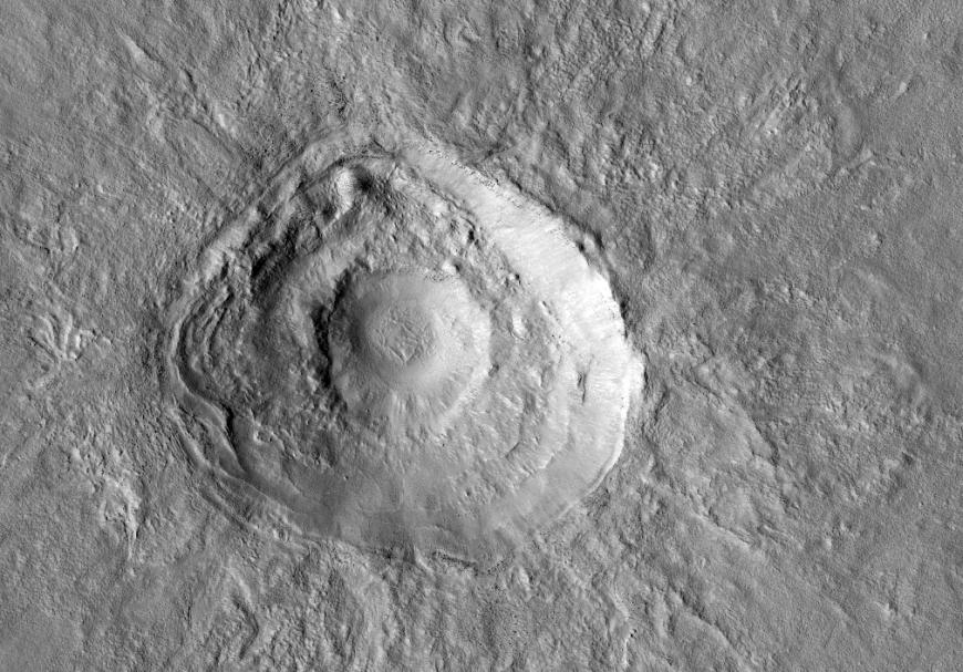 These terraced craters tell a complicated story about the planet's surface.