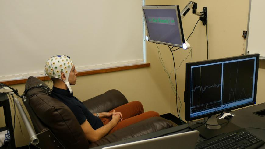 Study participant wears an electroncephalography (EEG) cap that records brain activity