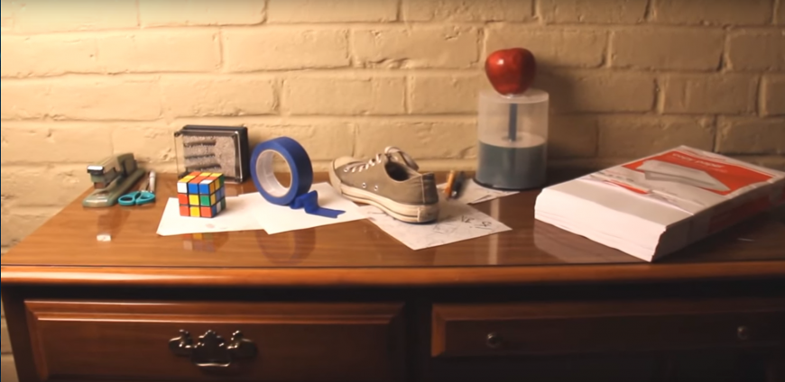 A desk with seemingly innocuous objects on top