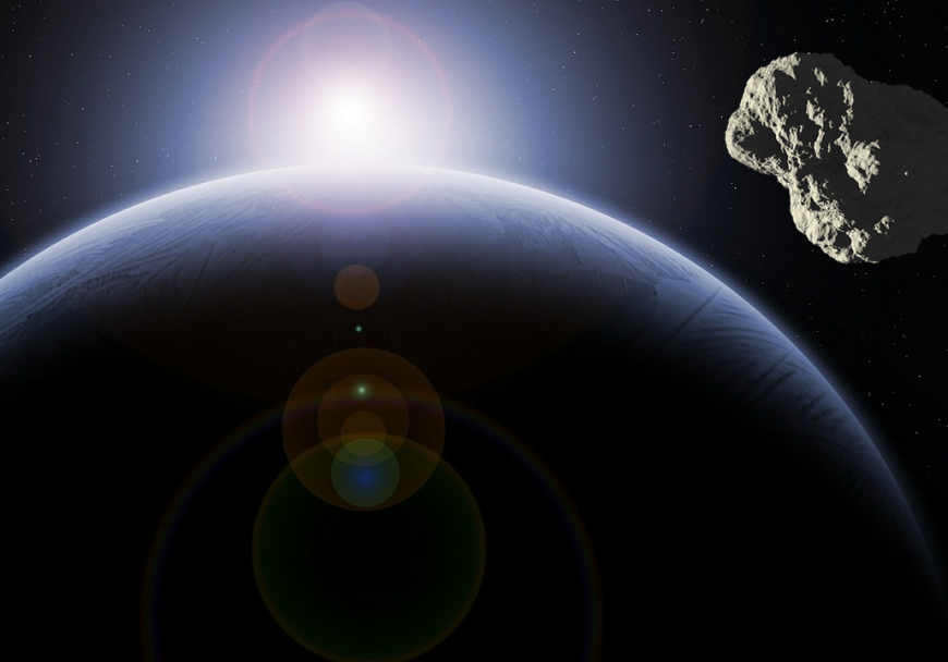 Depiction of an asteroid approaching the earth over a sunrise