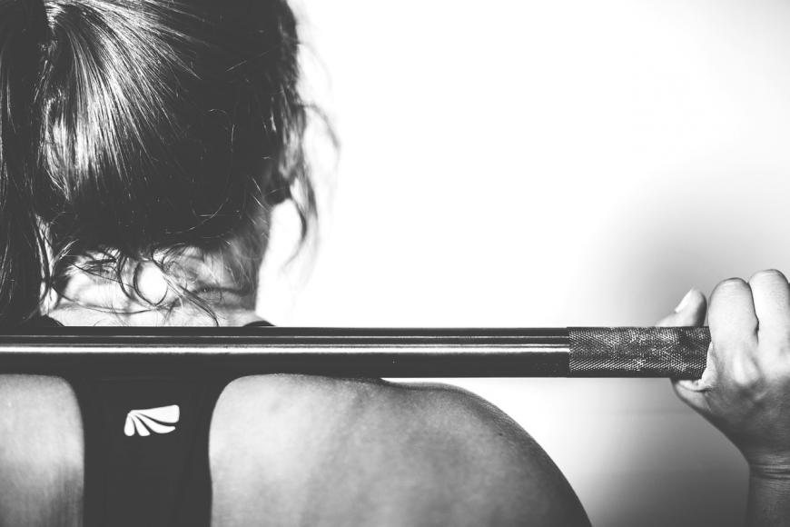 Woman weight-lifting. Black and white.