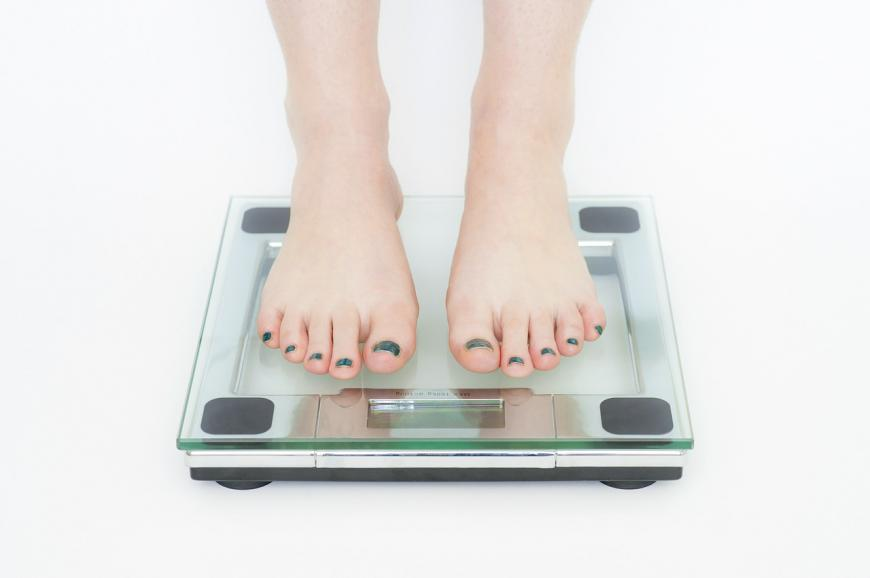 Standing on a scale. Body weight
