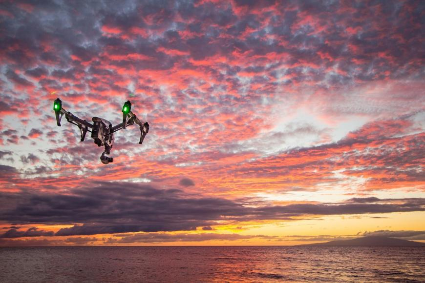 Drone flying into sunset