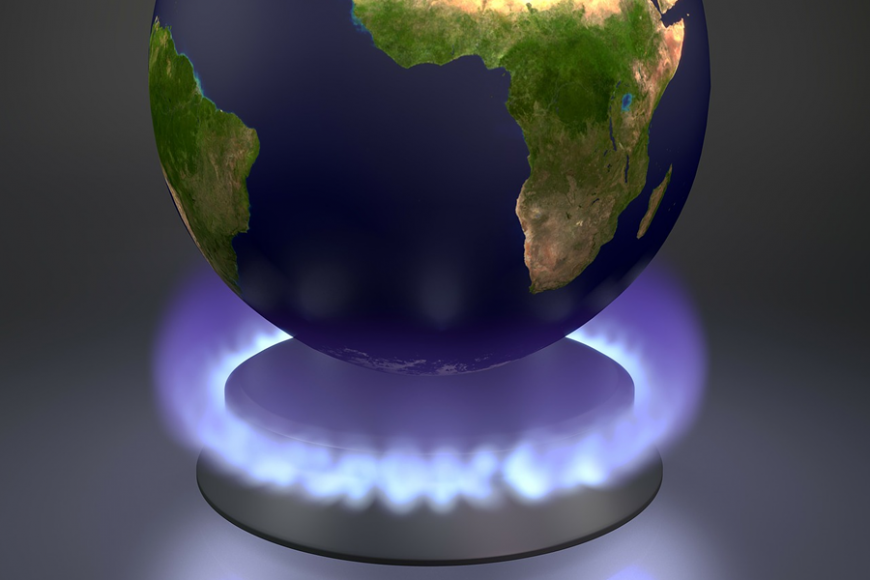 Global warming. A flame heats up Earth