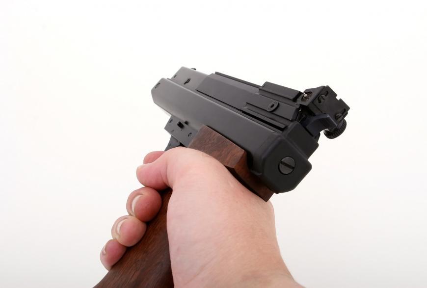 Hand holding a gun