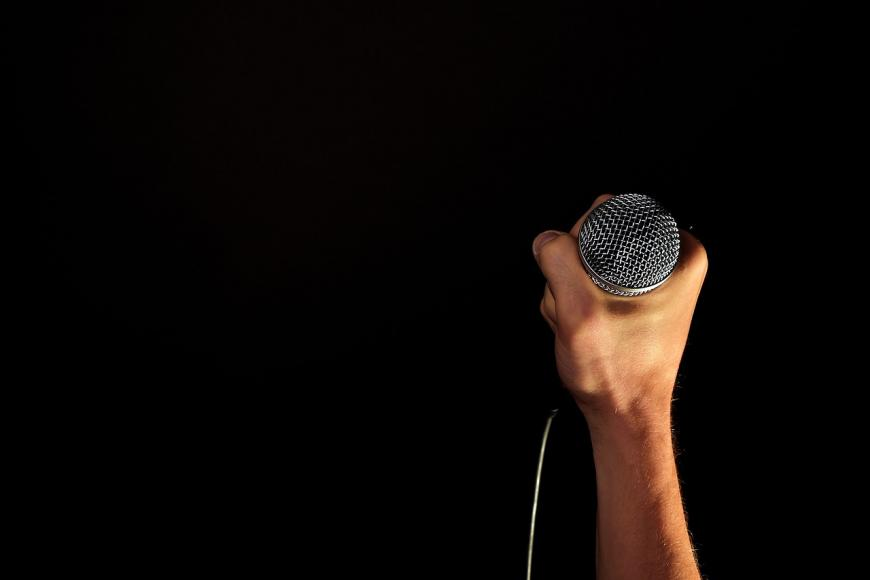 hand clutching a microphone.