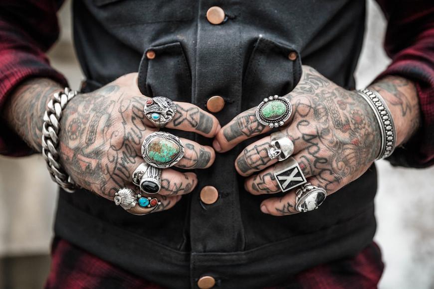 Tattooed hands of a man, rebel, bad boy