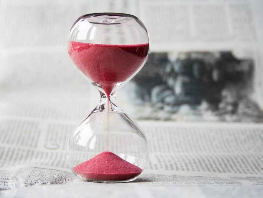 Hourglass on a newspaper