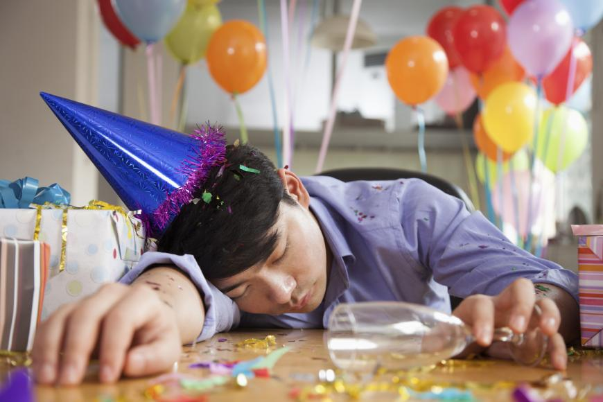 Drunk man passed out on table at birthday party