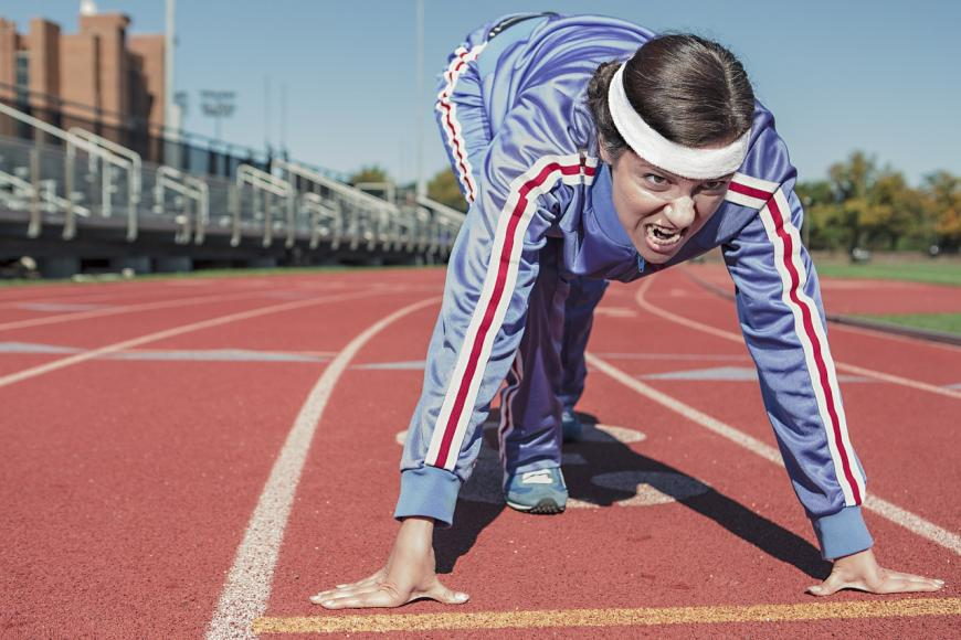 Runner prepares to sprint on track