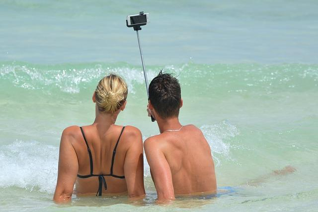 People taking a selfie at the beach.