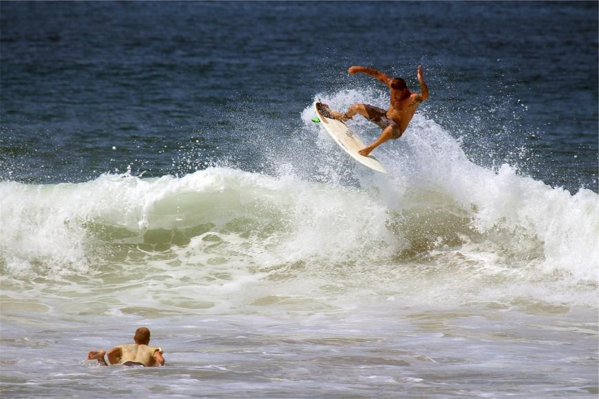 Two surfers, riding the waves