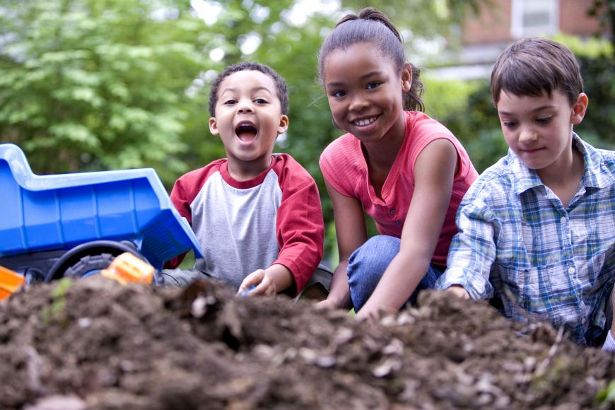 three children happily playing outdoors