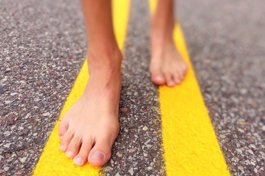 Bare feet on the road