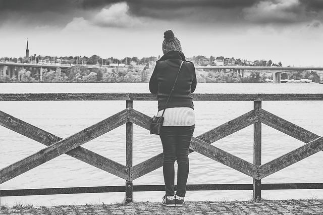 Depression - woman thinking, grey skies. CREDIT: qimono / Pixabay (CC0)