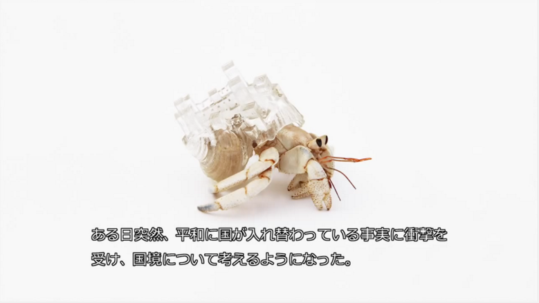 Hermit crab wearing a translucent shell shaped like the Ksar of Ait-Ben-Haddou skyline.