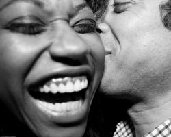 Black and white photo of a couple kissing