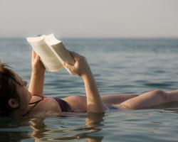 Woman reading a book like floating in the dead sea