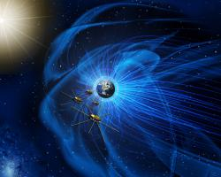 Artist's rendition of the four MMS spacecraft orbiting Earth and its magnetic field.