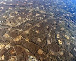 In areas where shale-drilling/hydraulic fracturing is heavy, a dense web of roads, pipelines and well pads turn continuous forests and grasslands into fragmented islands.
