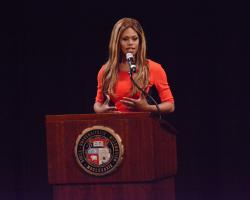 Laverne Cox speaking at an event in the Missouri Theatre